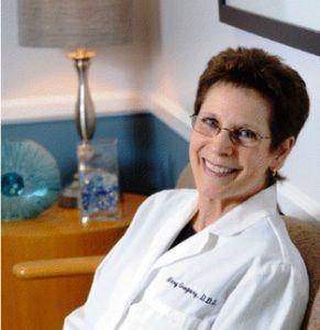 Dr. Mary Gregory, dentist in Arlington, Virginia, sitting near decorative table